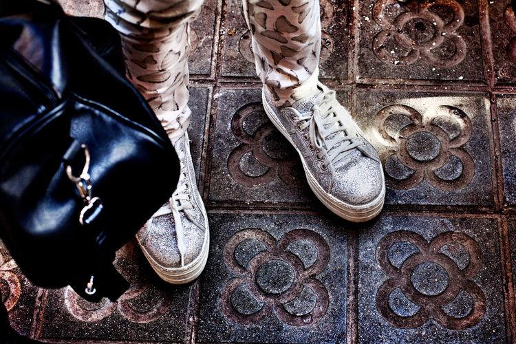 Glittery trainers, Barcelona. Black Handbag Clothing Fashion Girl Horizontal Human Leg Low Section Outdoors Pavement Real People Shoe Style Tack
