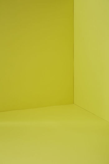 Full frame shot of yellow floor and wall