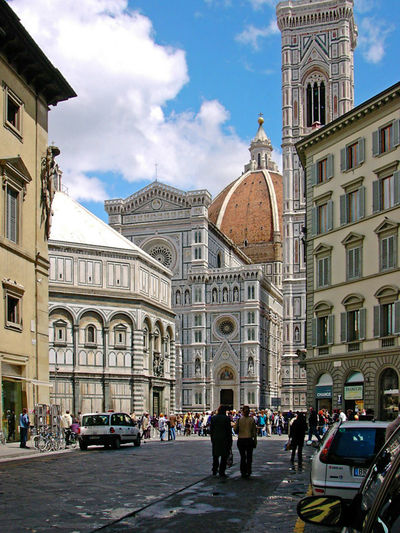 The Cattedrale di Santa Maria del Fiore - Florence, Italy Travel Destinations Tourism Street Spirituality Sky Religion Real People Place Of Worship People Outdoors Large Group Of People History Florenz Dome Day Cloud - Sky City Built Structure Building Exterior Architecture Arch The Cattedrale Di Santa Maria Del Fiore Florence Italy Duomo