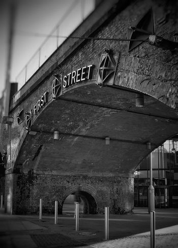 first Street part of my ongoing series of The Streets of Manchester Malephotographerofthemonth Monochrome Photography Blackandwhite Photography Creative Light And Shadow Manchester Streets Of Manchester Architecture Built Structure No People Bridge - Man Made Structure Day Travel Destinations Outdoors City