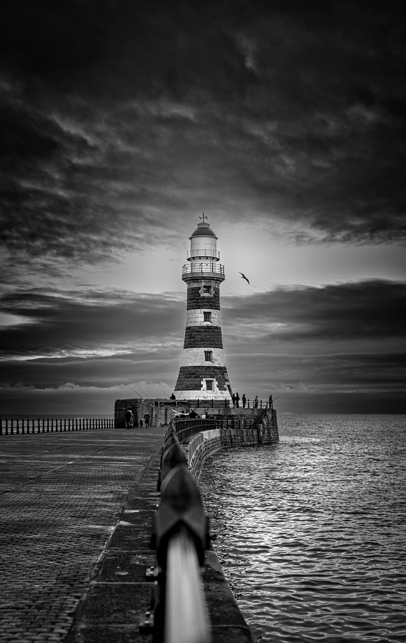 sky, water, cloud - sky, sea, architecture, built structure, tower, guidance, real people, direction, nature, lighthouse, building exterior, one person, scenics - nature, land, blurred motion, leisure activity, beauty in nature, horizon over water, outdoors