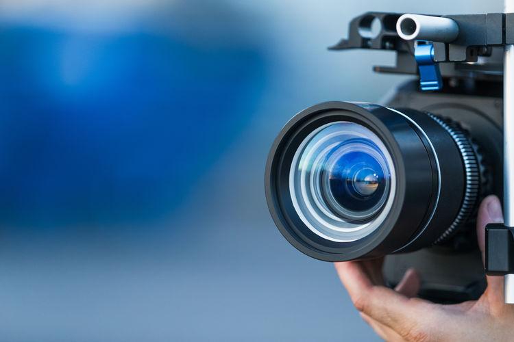 Close-up of hand holding movie camera