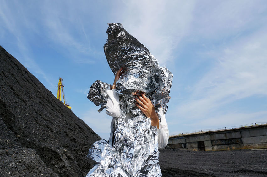 Alien Art And Craft Futuristic Hands Industrial Metallic Structure Weird Art Cloud - Sky Coal Cosmic Hiding Holding Industrial Landscapes Landscape Leisure Activity Low Angle View Martian  Martian Landscape Metallic Object One Person Outdoors Sky Strange