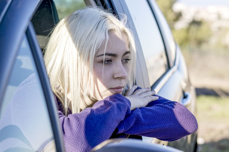 Portrait of woman sitting in car