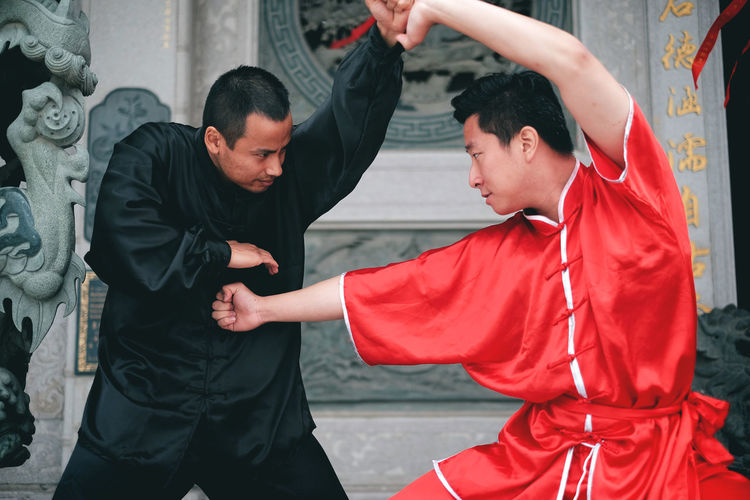 Shaolin kungfu. Adult Adults Only Dedication Human Body Part Indoors  Kungfu  Men Only Men People Two People Warrior Wushu Wushu Sanda Young Adult