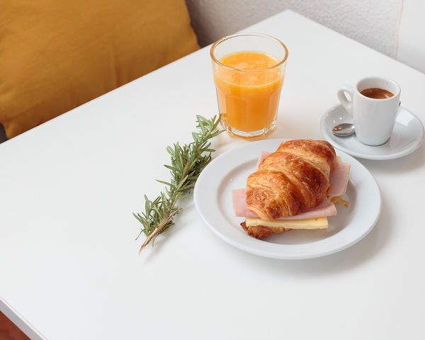 breakfast Bread Breakfast Close-up Coffee - Drink Coffee Cup Croissant Day Drink Drinking Glass Food Food And Drink Freshness Frothy Drink Healthy Eating Indoors  No People Orange Color Orange Juice  Plate Ready-to-eat Refreshment Serving Size Table