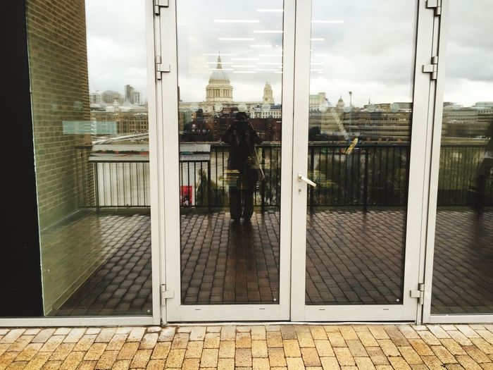 The Tourist Tourist Traveling Travel London St. Paul's Cathedral Skyline Reflection Doors Windows Showing Imperfection