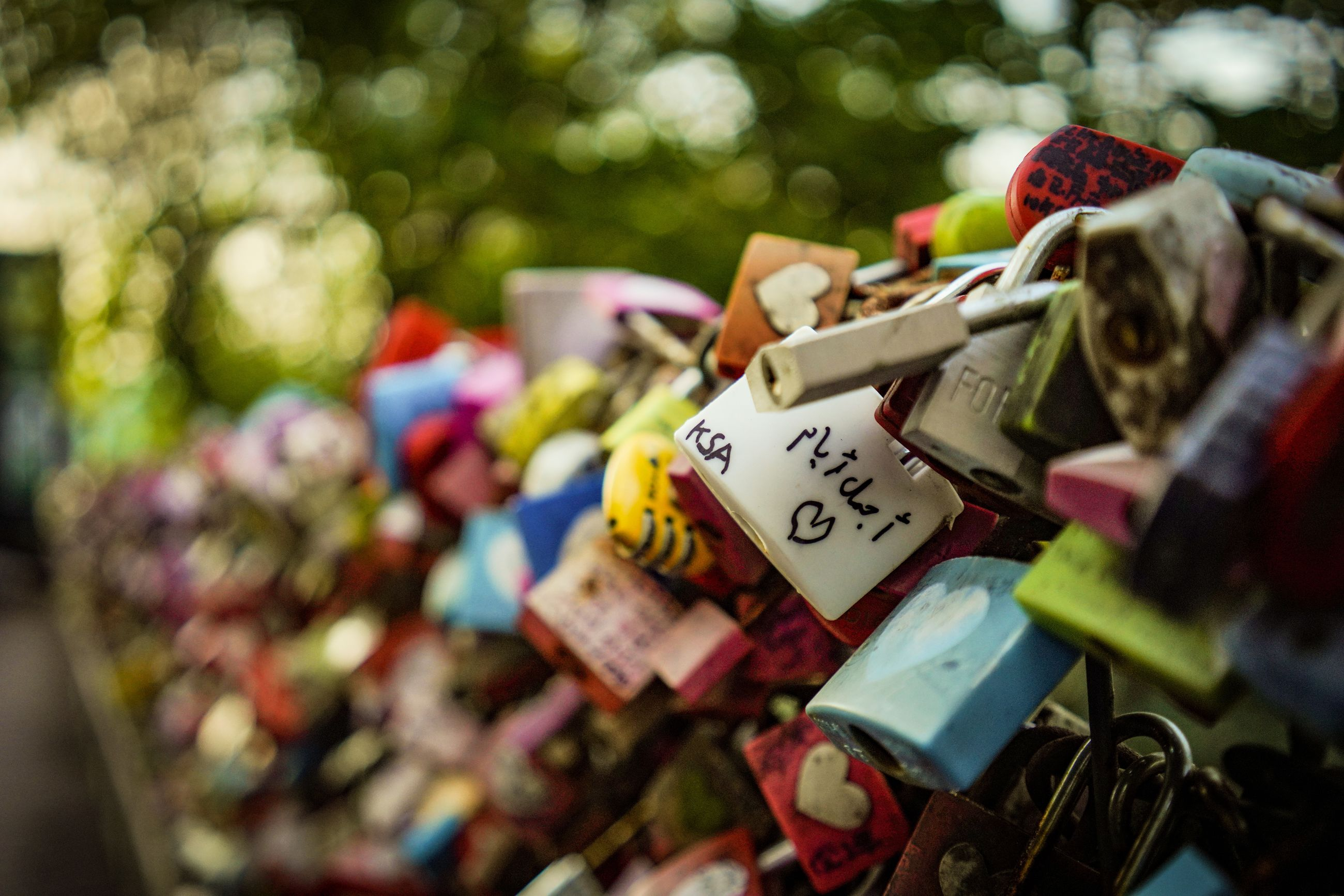 lock, padlock, large group of objects, abundance, protection, security, love, hanging, day, variation, choice, text, multi colored, love lock, safety, close-up, focus on foreground, no people, emotion, metal, positive emotion, outdoors
