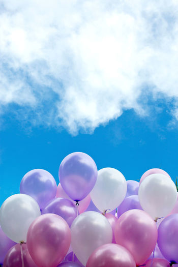 Colourful balloons with blue sky background. Balloon Cloud - Sky Sky Low Angle View Blue Nature Multi Colored Day No People Large Group Of Objects Helium Balloon Celebration Vulnerability  Outdoors Fragility Pink Color Mid-air Group Of Objects Lightweight Bunch Purple