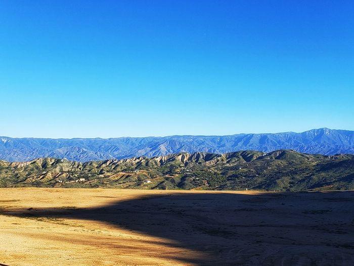 hills Sky Shadow Green Mointain View EyeEm Selects Clear Sky Beach Mountain Sand Blue Desert Sunny Sky Landscape Idyllic Scenics Sand Dune Tranquility Remote Tranquil Scene Rocky Mountains Arid Landscape Arid Climate Lakeside Non-urban Scene Mountain Range Countryside Horizon Over Water Calm Namib Desert