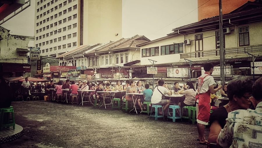 Penang Malaysia Penang Famous Street Food hawker food Road Side Dinning outdoor dinning Real People Large Group Of People Outdoors Hawkerfood Men People Adults Only Architecture Day Adult