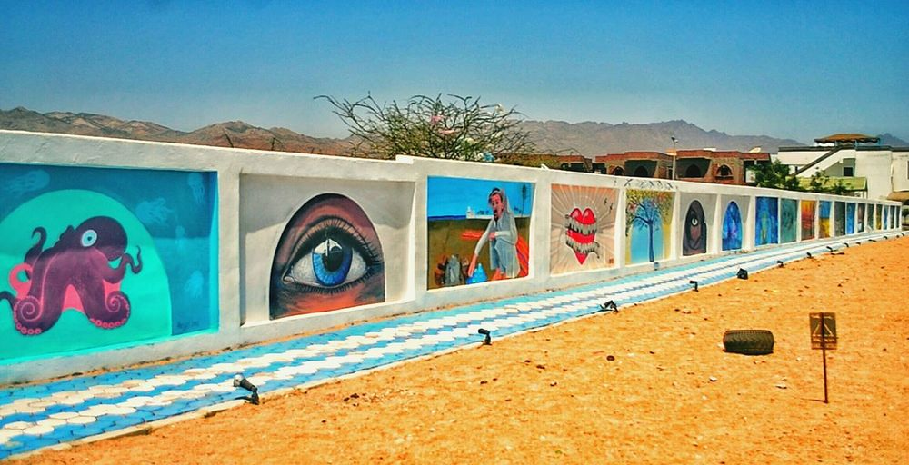 Multi Colored Day Outdoors Sky No People Vacations This Is Egypt ❤ Egyptphotography Travel Egyptian Art Tourism Dahab Saini Dahab Red Sea Travel Destinations Beauty Inside And Out Scenics Tranquility Beauty In Nature Nature Sand Architecture Photographer Wall Graffiti Dahab Festival Artworks