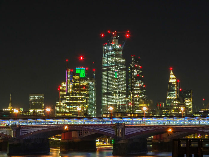 London by night London Architecture Built Structure Night Illuminated Building Exterior City Building Sky Tall - High Office Building Exterior Skyscraper Connection No People Bridge Bridge - Man Made Structure Water Nature Urban Skyline Tower Modern Cityscape Outdoors Financial District