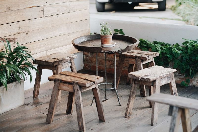 Absence Cafe Chair Day Empty Flooring Flower Pot Food And Drink Front Or Back Yard Furniture High Angle View Leaf Nature No People Outdoors Plant Plant Part Potted Plant Seat Table Wood - Material