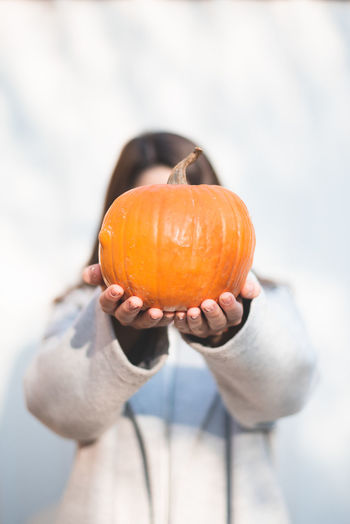 Autumn Mood Holding Food And Drink Food One Person Hand Focus On Foreground Human Hand Pumpkin Orange Color Human Body Part Freshness Wellbeing Healthy Eating Fruit Close-up Lifestyles Day Halloween Vegetable Outdoors Jack O' Lantern Finger Ripe