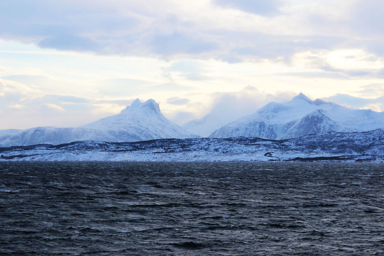 Sea and mountain in Bodø Bodø Norway Mountain Beauty In Nature Scenics - Nature Sky Snow Cold Temperature Cloud - Sky Water Environment Tranquil Scene Winter Waterfront Landscape Tranquility No People Snowcapped Mountain Nature Day Mountain Range Outdoors Ice Mountain Peak Range