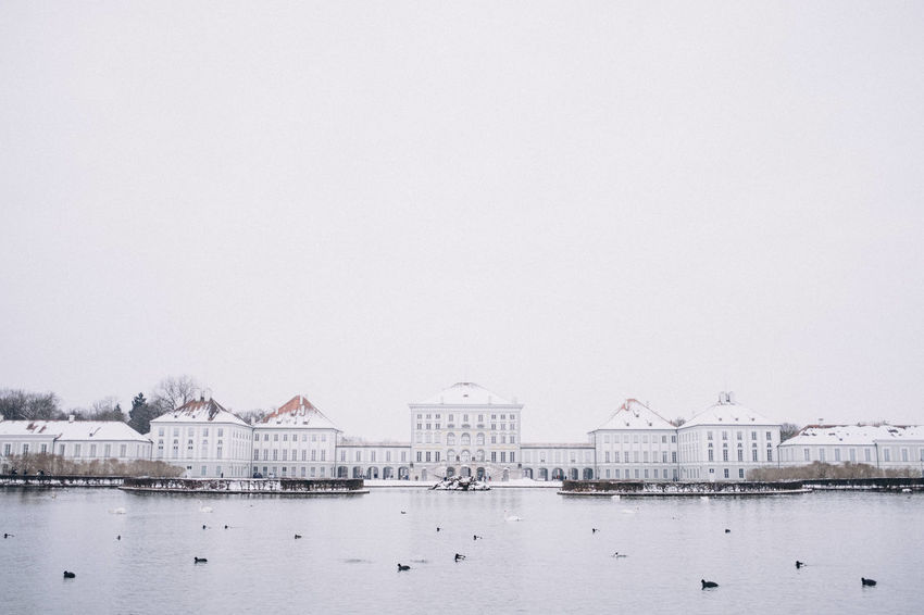 Nymphenburg Palace in winter, Munich, Bavaria, Germany. Bavaria Copy Space Horizontal Munich Nymphenburg Palace Tourist Attraction  Travel Photography Winter Architecture Building Exterior Built Structure Clear Sky Cold Temperature Copy Space Day Europe Germany Lake Landmark Nature No People Outdoors Schloss Nymphenburg Sky Snow Symmetry Travel Destinations Water Waterfront Winter