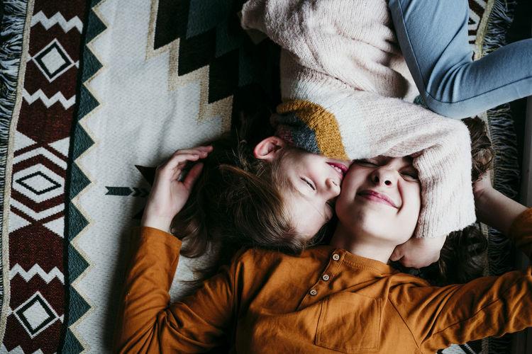 Portrait of girl lying on bed