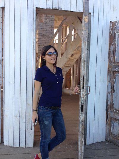 Woman Looking Away While Standing At Doorway