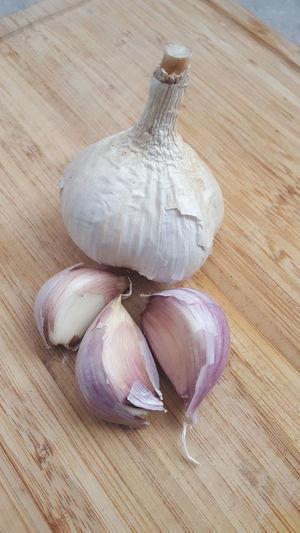 Garlic bulb gyo organic chef wooden cutting board kitchen Freshness Garlic Food And Drink Garlic Bulb Garlic Clove