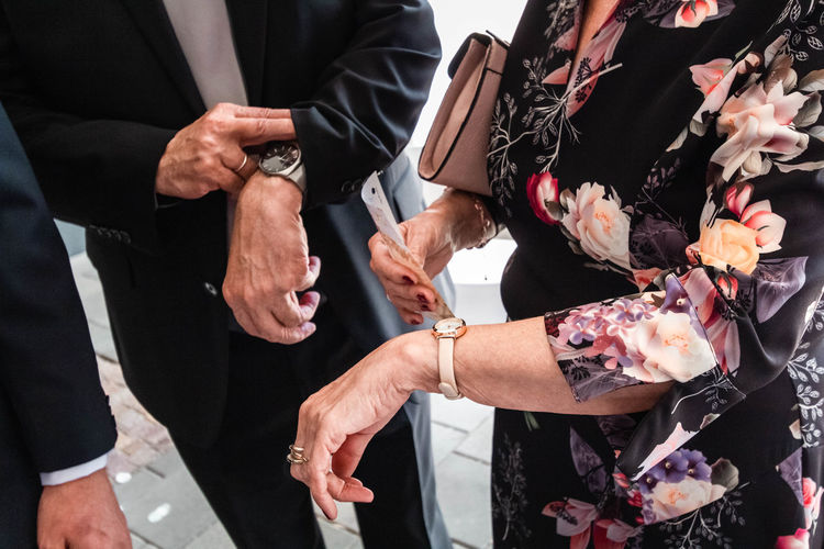 midsection of couple holding hands Time Is Money Adult Business Businessman Businessmen Businesspeople Businesswoman Celebration Ceremony Colleagues Communication Corporate Event Executive  Finance Flower Group Group Of People Hand Hands Happy Holding Human Hand Job Love Male Man Manager Meeting Men Midsection Newlywed Office Partner Partnership People person Positive Emotion Professional Real People Success Successful Suit Team Teamwork Time Together Togetherness Wedding Wedding Ceremony Well-dressed Women Work Working A New Beginning The Art Of Street Photography