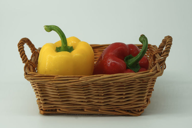 Close-up of bell peppers in basket