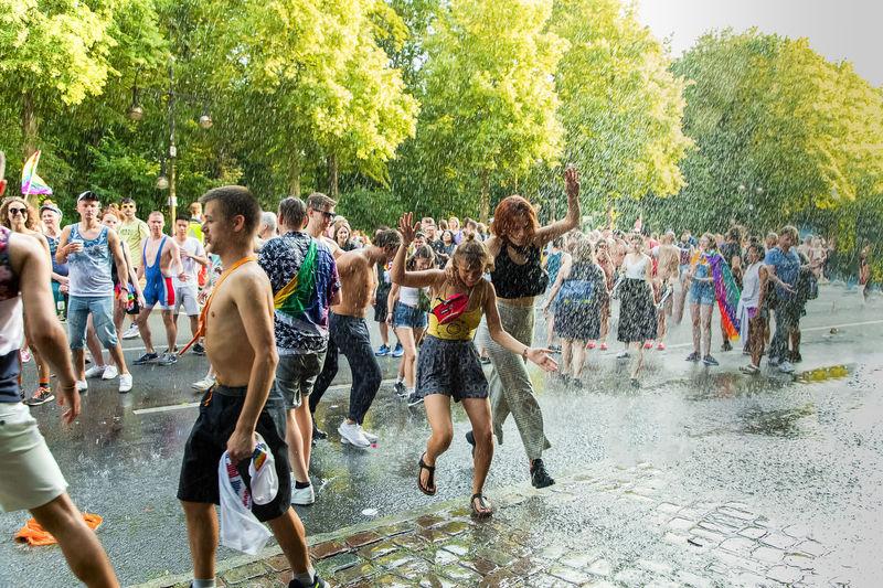 Group of people walking in water