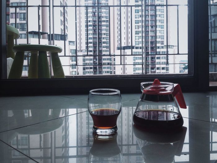 Coffee In Jug And Glass On Floor At Home