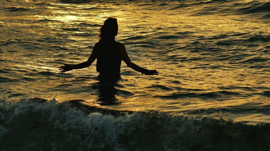 Ocean Waves Woman Power Waves, Ocean, Nature Silhouette_collection Woman In Water Beach Meditation Time Alone The Great Outdoors With Adobe The Great Outdoors - 2016 EyeEm Awards 43 Golden Moments