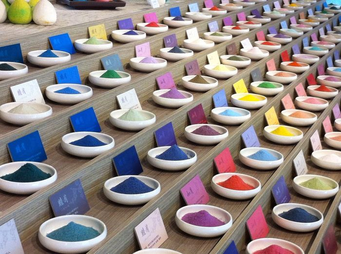 High angle view of multi colored powder paints for sale in market