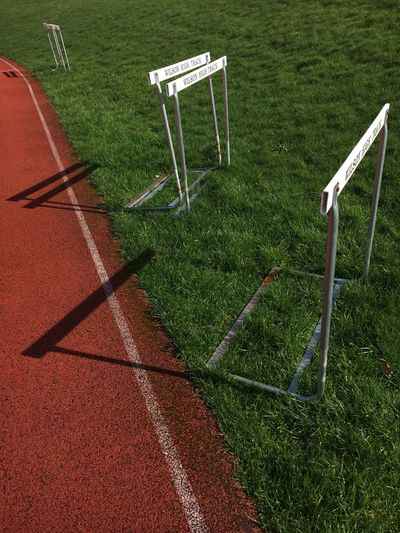 Grass Green Color No People Sport Outdoors Sunny Day Track Hurdles Hurdle Hurdle Practice Regrind Grass Grassy Shadow