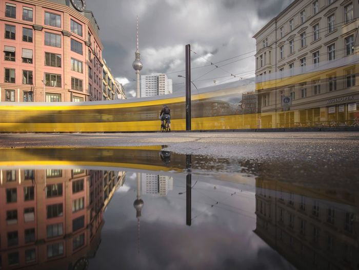 Reflection of buildings in puddle