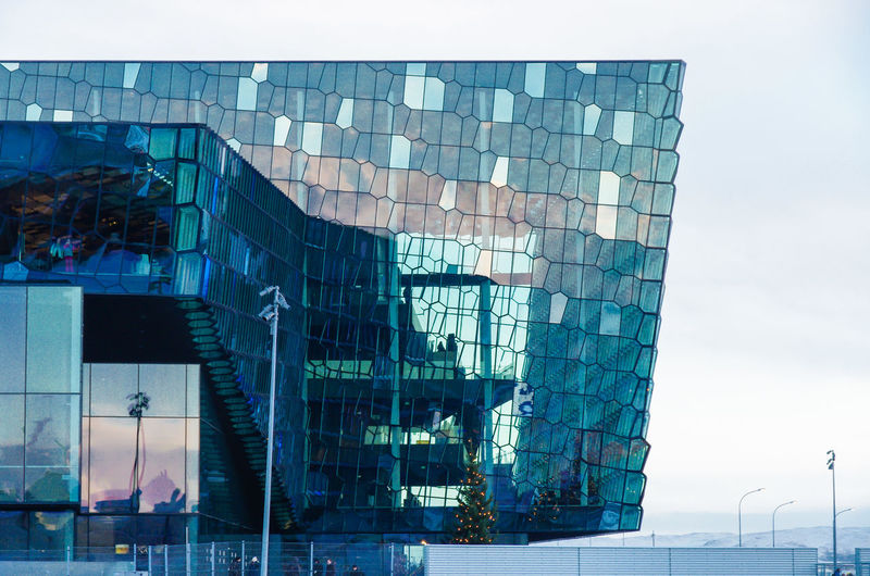 Harpa Concert Hall in Reykjavik European Architecture Harpa Iceland Modern Architecture Reflection Reyjkavik Sightseeing Architecture Beautifil Building Building Exterior Built Structure Capital Cities  City Concert Hall  Famous Place Glass - Material Glass Architecture Glass Fronted Building Iceland_collection Island Landmark Modern Reflection Sunset