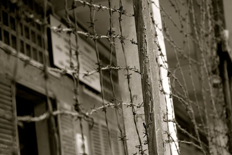 Abandoned Bad Condition Barbed Wire Cambad Close-up Day Dead Plant Destruction Deterioration Dry Fence Focus On Foreground Metal No People Outdoors Phonm Pemh Protection Ruined Safety Security Sharp Tuol Seng Pr Twig