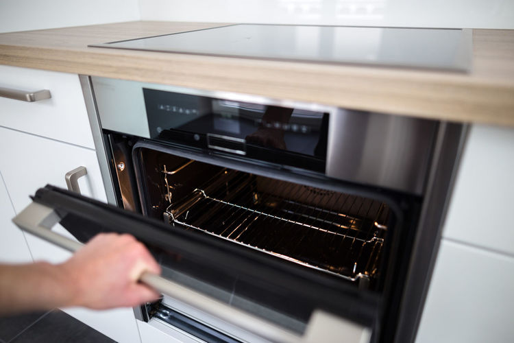 Architecture Baking Oven Bright Close-up Cooking Design Food Food Preparation Hot Air Human Hand Indoors  Kitchen Lifestyle Luxury Modern Oven Stove Technology