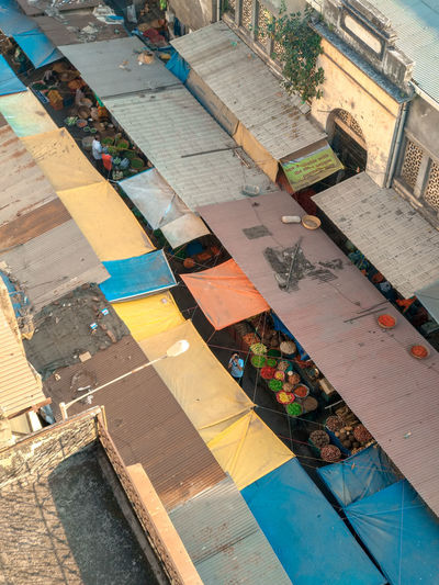 High angle view of buildings by swimming pool in city