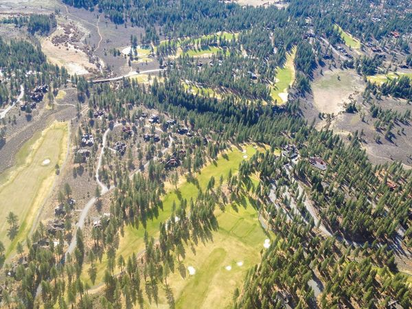 Aerial View of a Golf Course at foot of the Sierra Nevada Mountains in Truckee  California .