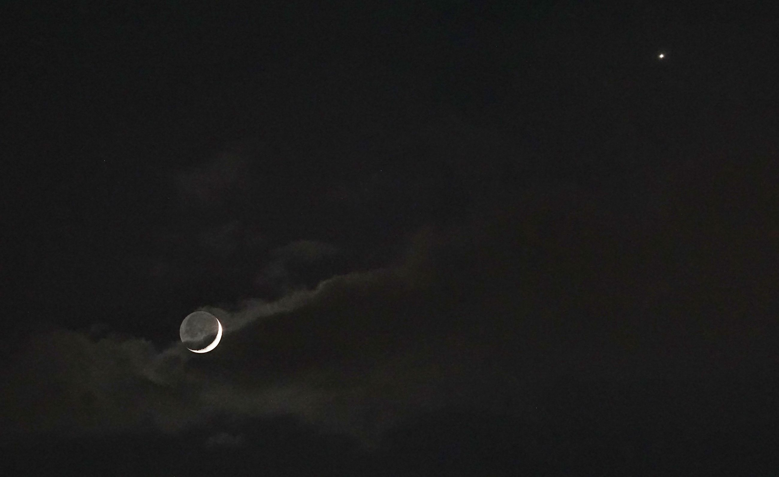 sky, moon, night, beauty in nature, copy space, scenics - nature, low angle view, planetary moon, astronomy, space, tranquility, nature, no people, cloud - sky, tranquil scene, crescent, outdoors, dark, space exploration, discovery, eclipse, space and astronomy