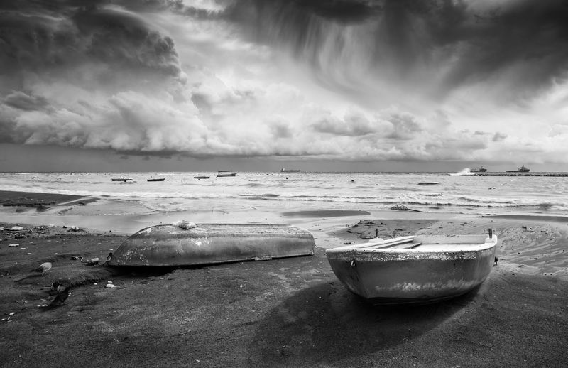 Boats resting on the seashore and stormy cloudy sky Bad Weather Cloudscape Cyprus Fishing Boats Nature RainDrop Seascape Photography Seashore Storm Stormy Weather Boats And Sea Boats And Water Clouds Clouds And Sky Limassol Cyprus No People Non-urban Scene Sea And Ocean Seascape Stormy Sky