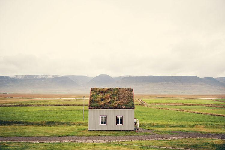 Built structure on landscape against sky