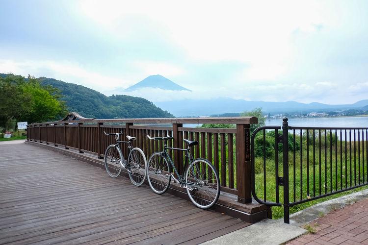 Cycling around lake Kawaguchiko Fujisan Japan Kawakuchi Beauty In Nature Bicycle Cloud - Sky Lake Mountain Nature Outdoors Sky Water