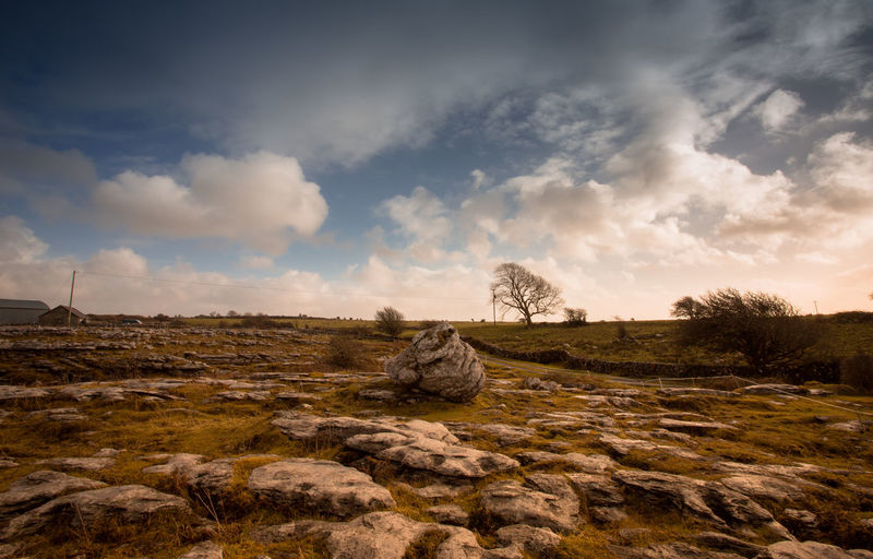 Ireland Ireland🍀 Irelandinspires Ireland Landscapes Ireland Lovers Sky Cloud - Sky Rock Solid Rock - Object Nature Tranquility Land No People Tranquil Scene Beauty In Nature Environment Landscape Scenics - Nature Non-urban Scene Field Plant Day Tree Outdoors Eroded Sandstone