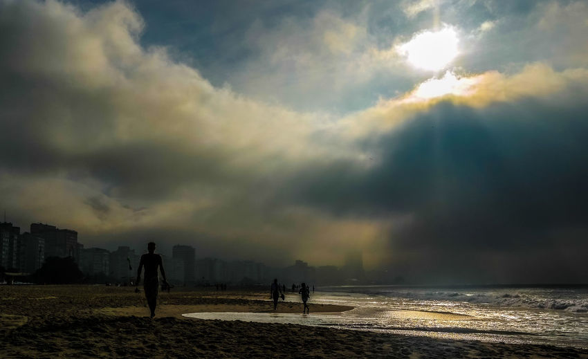 Atmosphere Atmospheric Mood Cloud Cloud - Sky Cloudscape Cloudy Copacabana Distant Dramatic Sky Light Majestic Moody Sky Orange Color Outdoors Rio De Janeiro Scenics Silhouette Sky Storm Cloud Sun Sun Rays Sunset Tranquil Scene