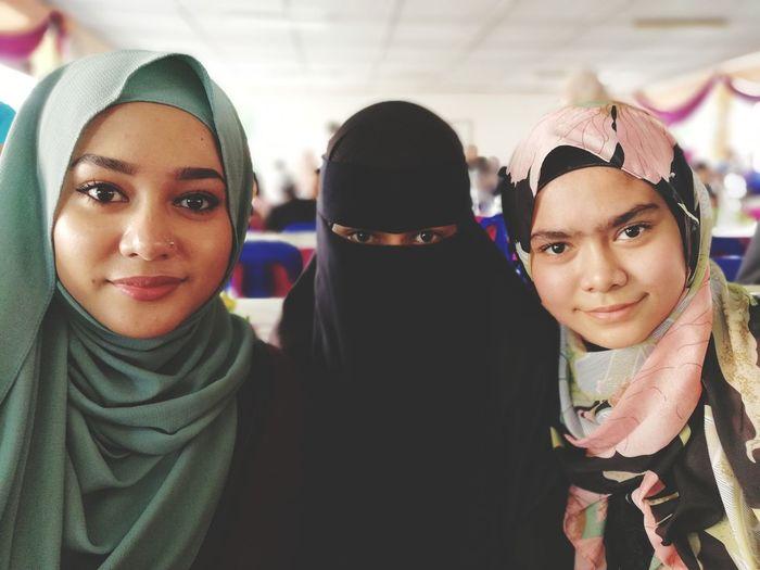 Portrait Of Siblings Wearing Hijab