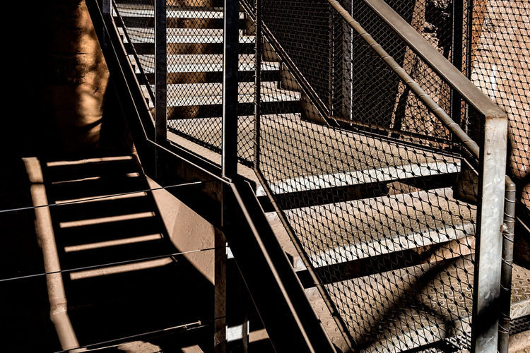 Industrial Absence Architecture Building Built Structure Day Direction High Angle View Indoors  Ladder Light And Shadow Metal No People Pattern Railing Seat Shadow Staircase Steel Steps And Staircases Sunlight Way Up