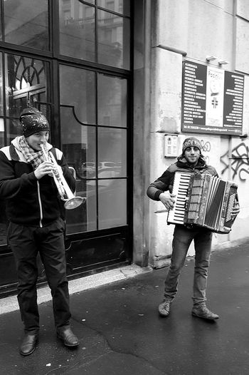 Music Two People Adults Only Musical Instrument Musician Built Structure Outdoors Day Adult People Saxophone Streetphotography Street Photography Streetphoto_bw City Life Blackandwhite Blackandwhite Photography Black And White Embrace Urban Life