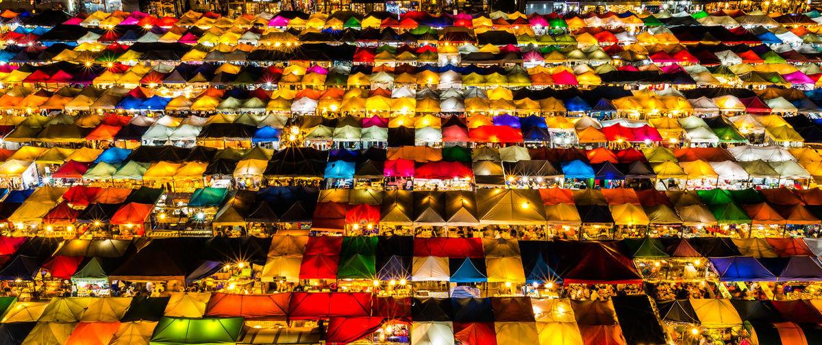 Full frame shot of multi colored parasols at market