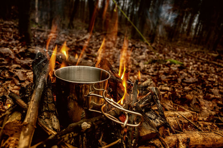 Water In Metallic Container On Campfire At Forest