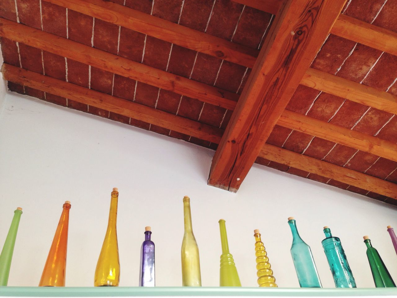 Low Angle View Of Colorful Bottles Decorated In Kitchen