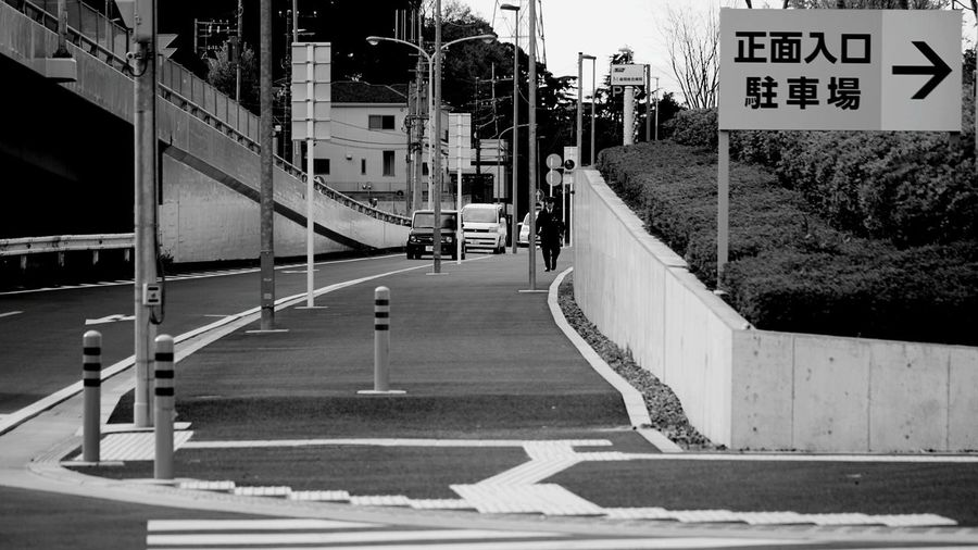 Road Sign Road City Built Structure Day No People Architecture Outdoors EyeEmNewHere Black And White Friday Policeman